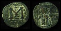 Ancient Coins - ISLAMIC, Umayyad Caliphate. Arab-Byzantine Coinage (Standing Emperor Type). Circa 680s. Æ Fals, 19mm Rare!